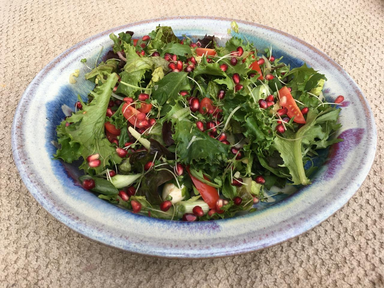 Large shallow bowl with a summer salad.