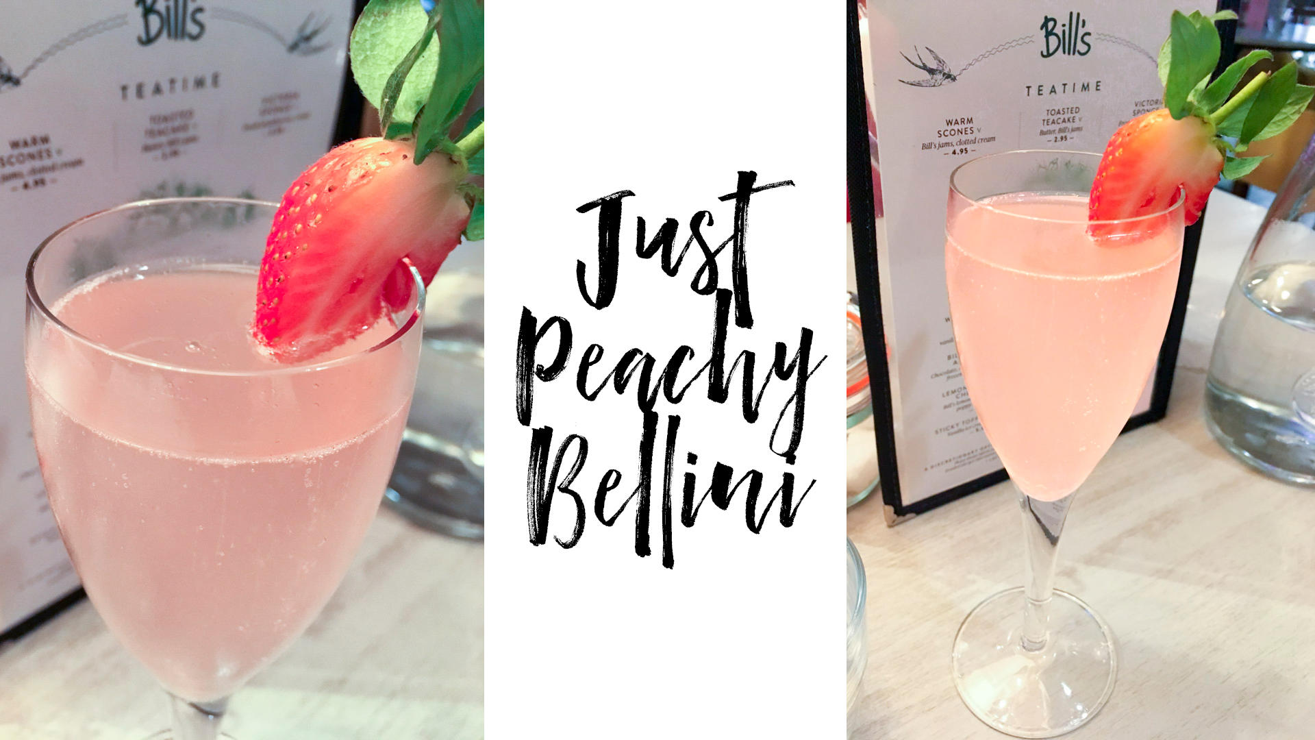 A peach bellini cocktail with a sliced strawberry on the rim.