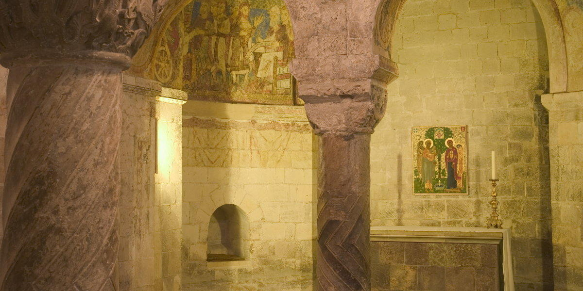 A small chapel inside Canterbury Cathedral with original paintings on the walls