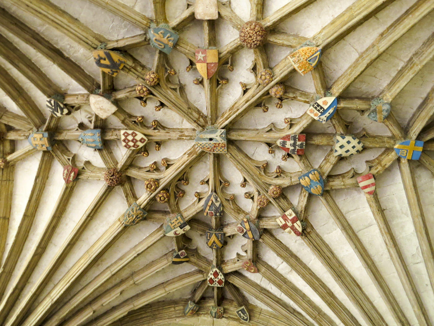 A ceiling in the cloisters of Canterbury Cathedral decorated with coats of arms