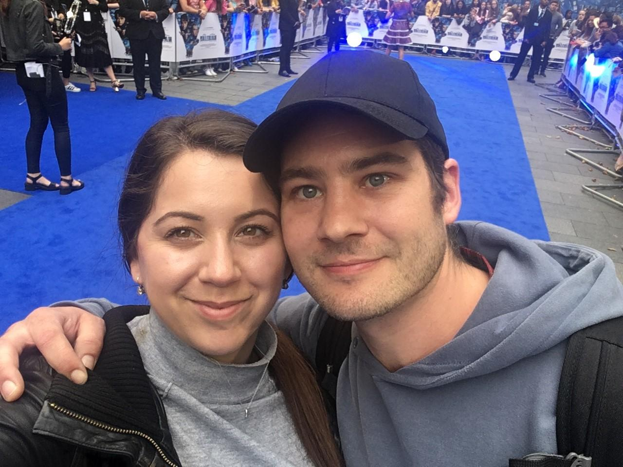 A couple taking a selfie on the blue carpet in London's Leicester Square
