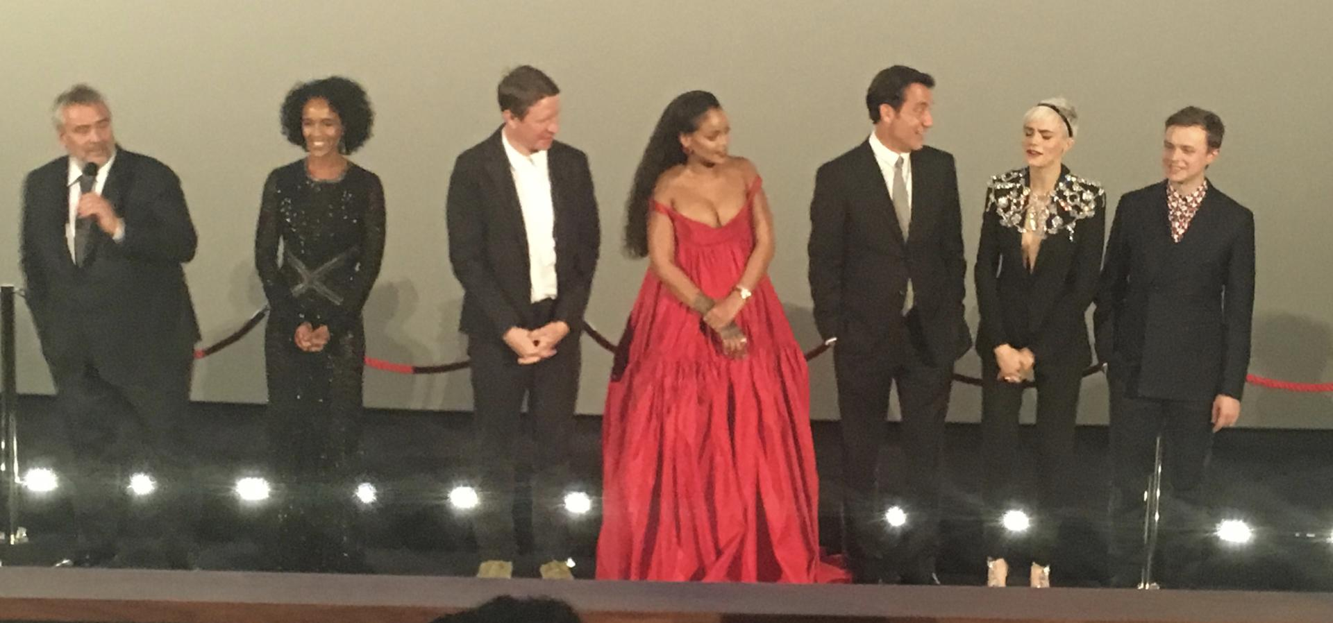 Line up of film stars before a premiere in a cinema.