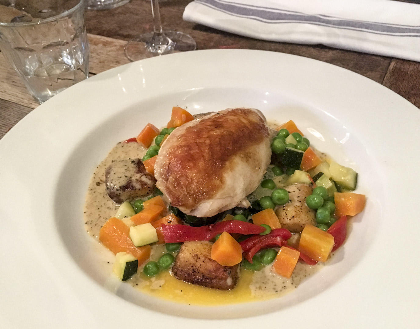 Deeson's roast skin on chicken breast with summer vegetables and old Winchester gnocchi.