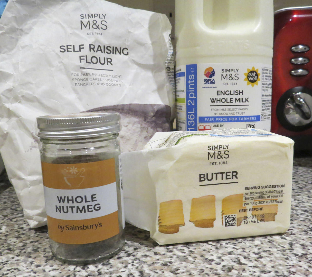 Ingredients for a béchamel sauce - self raising flour, nutmeg, butter and milk.