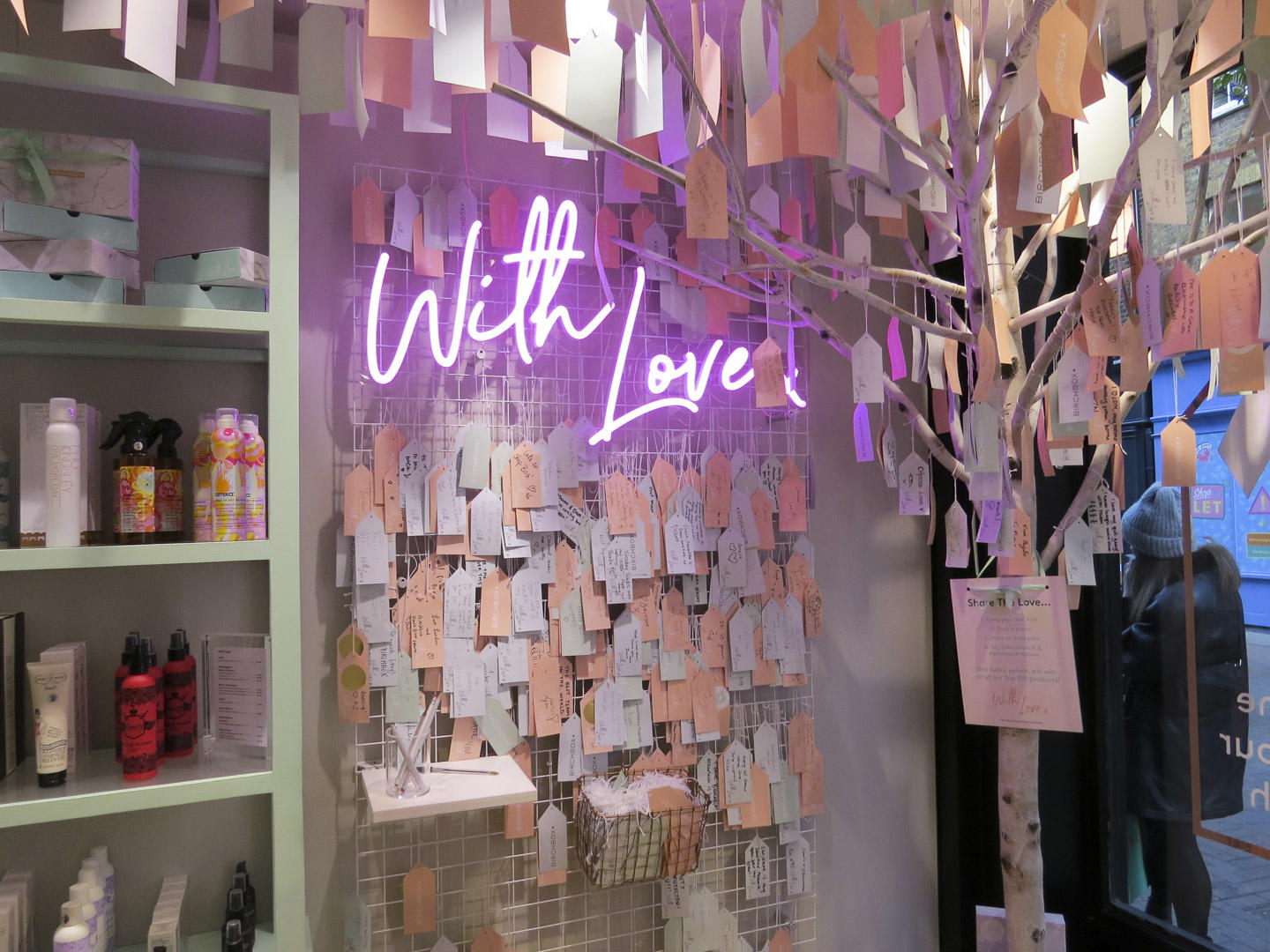 with love neon sign inside the Birchbox pop up shop
